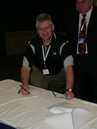 Kevin Colley signing the MOU between the ETA and EWRB on behalf of ETA