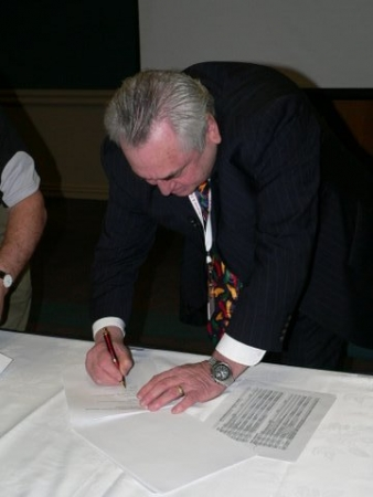 Murray Willis signing the MOU between the ETA and EWRB on behalf of EWRB